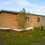 New stained log siding